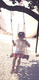 Swinging in the playground with a pupil from the Wonderworld Nursery school & Kindergarten in Larnaca, Cyprus