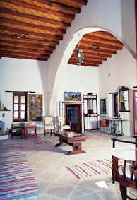 High wooden beamed ceilings and stone flagged floors, the proper way to build for the climate in Cyprus.